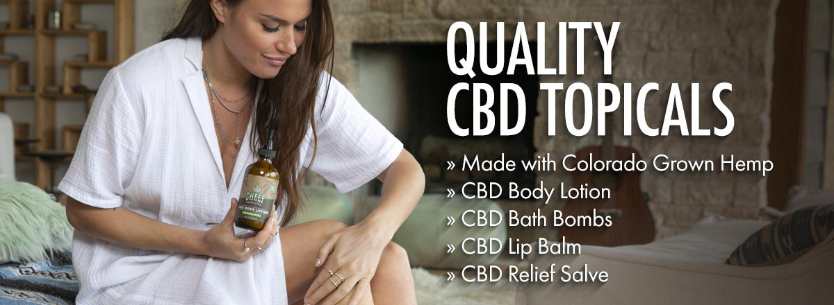 Cheef Botanicals CBD Topicals full page banner girl rubbing lotion on knee