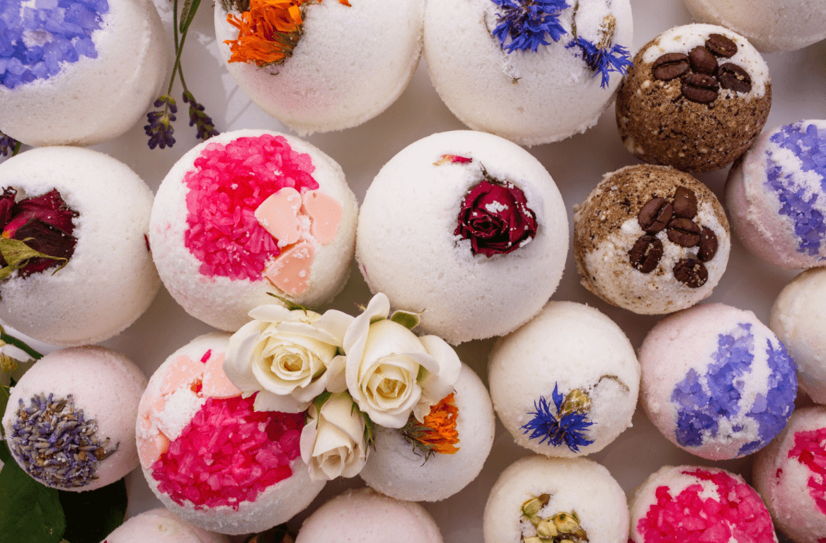 wide selection of bath bombs with flowers and coffee beans